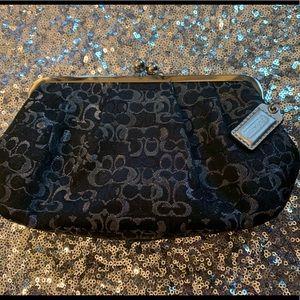 Coach black and silver Signature Clutch bag